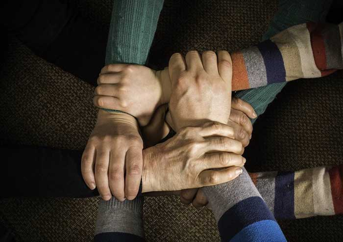 photo of people supporting each other