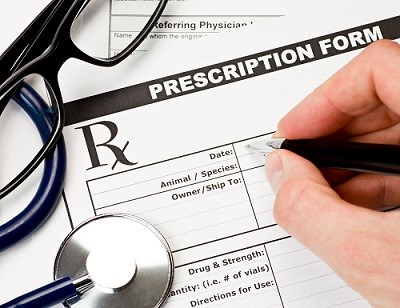 Image showing a prescription medication form being filled in