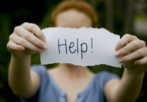 Image showing a women holding a sign for help