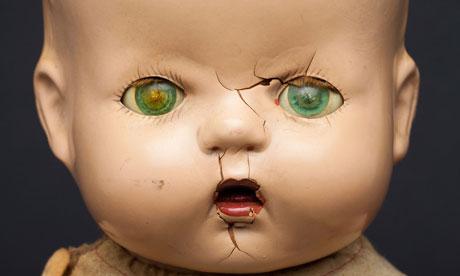 A broken doll, symbol of a broken child