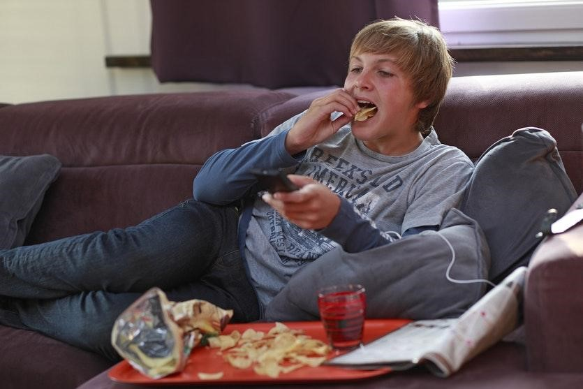 Image showing a boy overeating compulsively