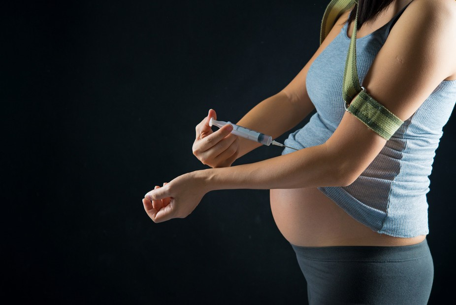 Image showing a woman trying to use cocaine during pregnancy
