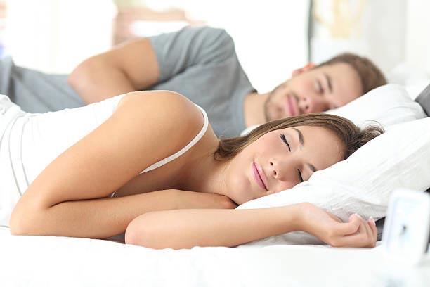 image of a couple sleeping
